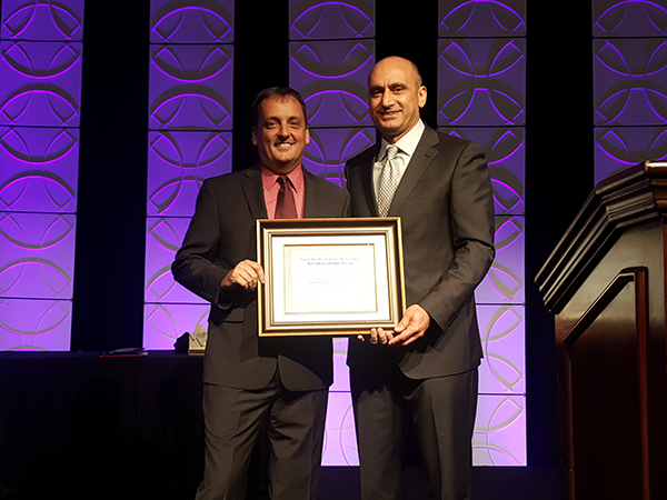 Dr. Soner Tarim receiving Leader of the Year Award